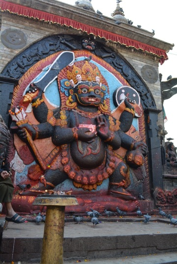 Kal Bhairab the Hindu God of destruction a nasty manifestation of Vishnu holding the 5 heads and the body of various victims.