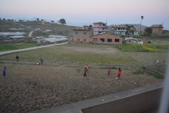 The local kids have made the vacant block in front of the house their own football field. Some of the toddlers watch dreaming of the day when they can play with the big boys. Very cute