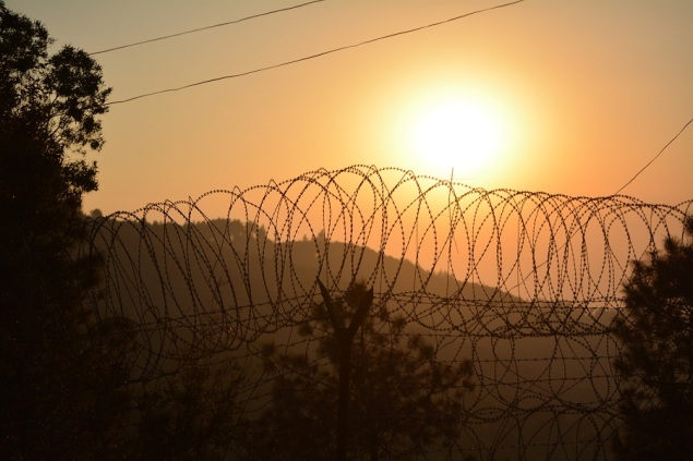 Sun setting over the Gorkha Ranger base, this demonstrates the thickness of the haze produced by Kathmandu