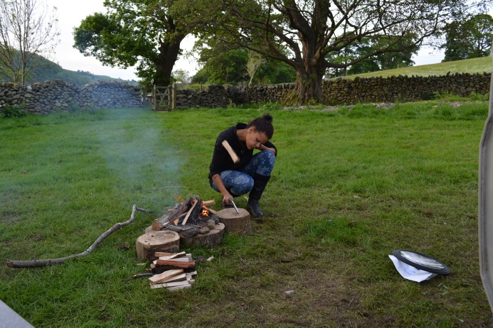Whilst I chopped wood with his Nepalese Kukri (heavy thick curved knife)