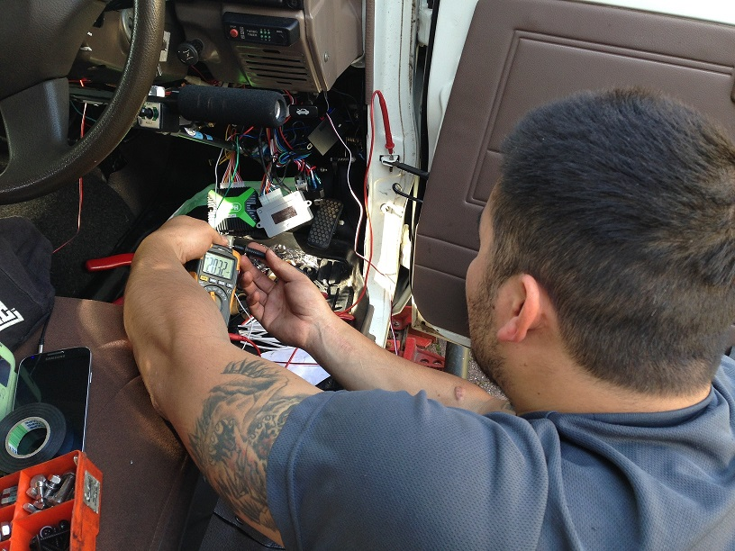 Jerome wiring up and fitting a car alarm and immobilizer.