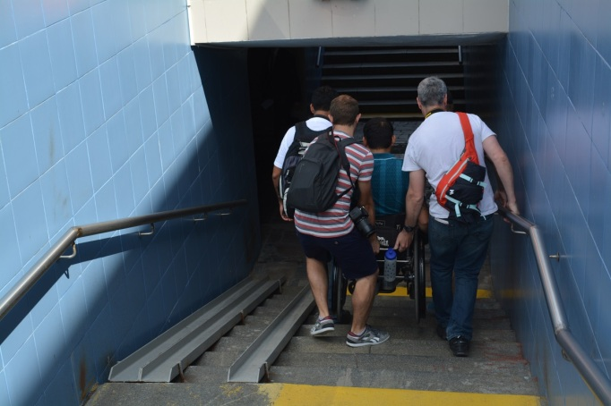Some really great guys from our free tour carrying Jerome down the stairs to the underpass.... Note the sketchy 'ramps' which have been placed there as part of the new initiative to make Moscow more accessible.