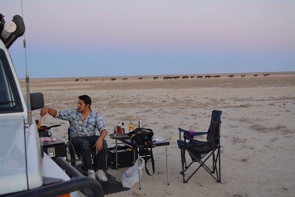 Camping on a salt pan with the horses and camels