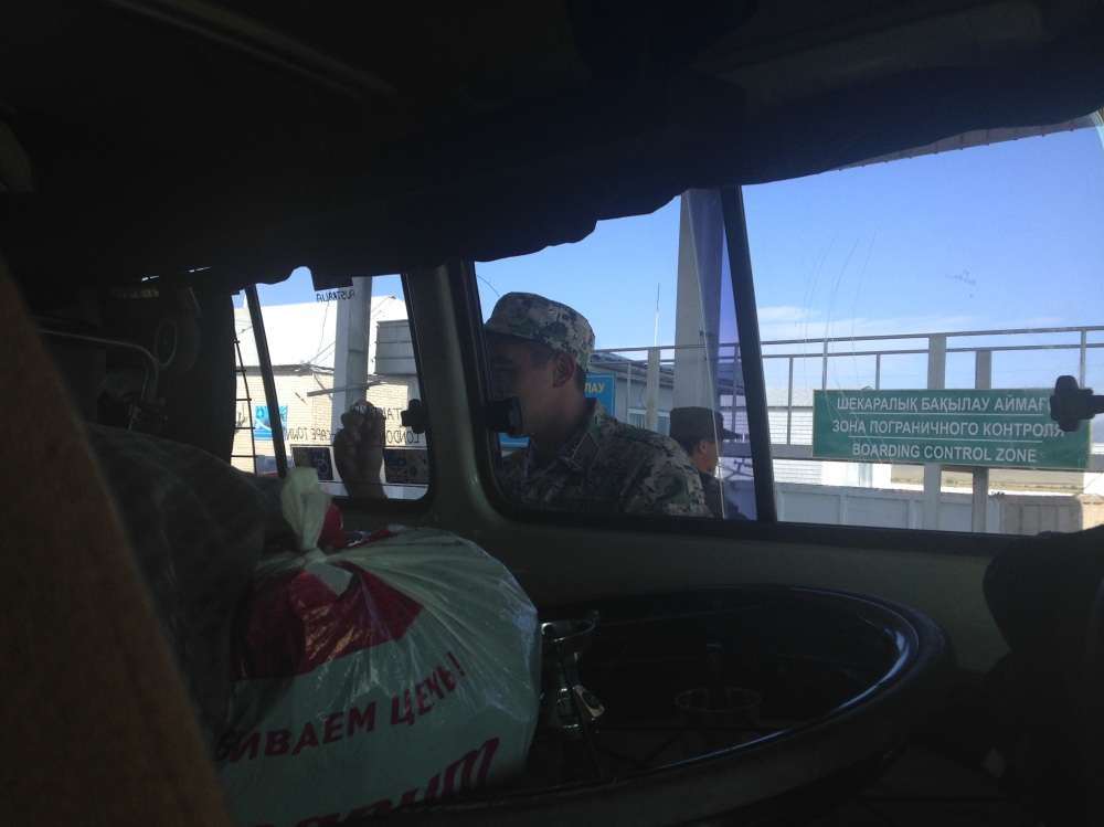 The border guards writing their home-towns on our Troopy windows using tip-ex ;)