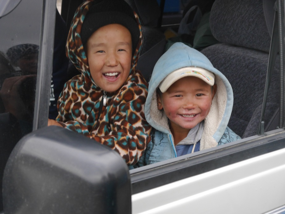 Some really cute Kyrgyz children having a go at being the driver