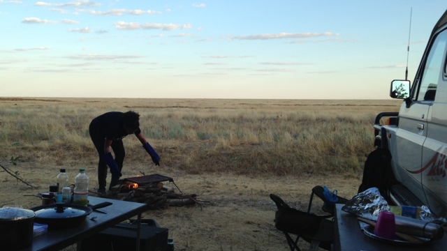 Getting the hotplate out over the fire. Can't see all the rubbish left behind by the locals here. Horrible.