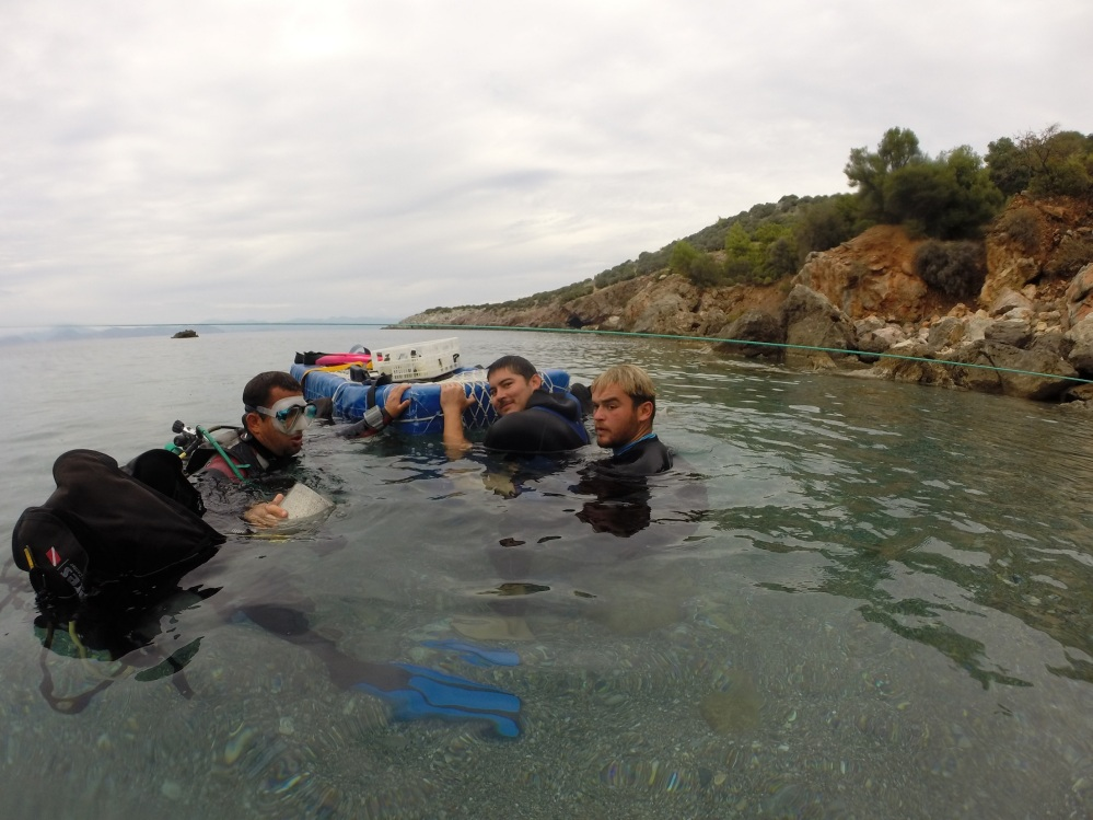 Sneak preview of diving with the team helping Jerome to get his gear on.