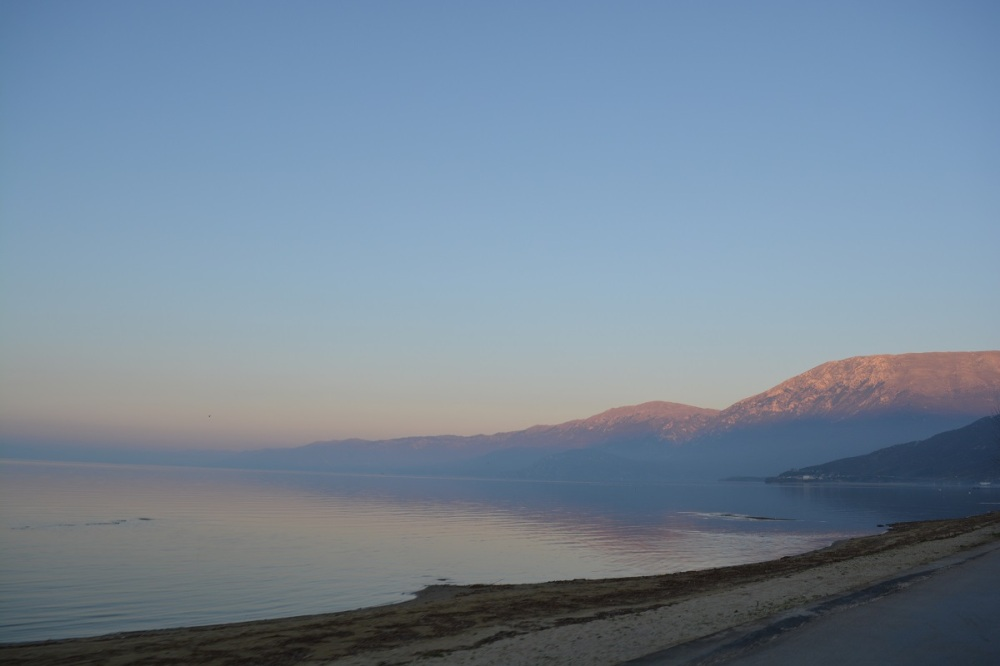 The shores of Lake Presper just before sunset and the Macedonian border.