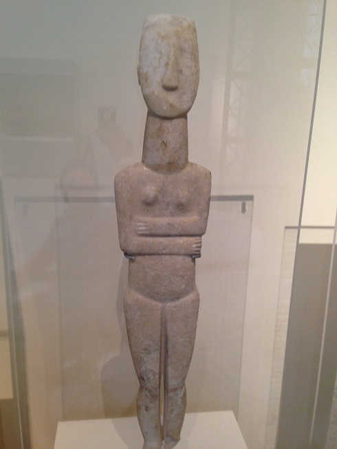 This is a Cycladic female figure from 2800-2300 BC! It is one of the best preserved sculptures of that size from that era. There are even traces of the original coloring in the hair and eyes still.